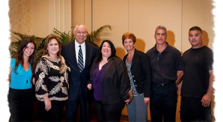 Image: Colin Powell poses with corporate event attendees. Conference and event speaker selection services by Benchmarc360.