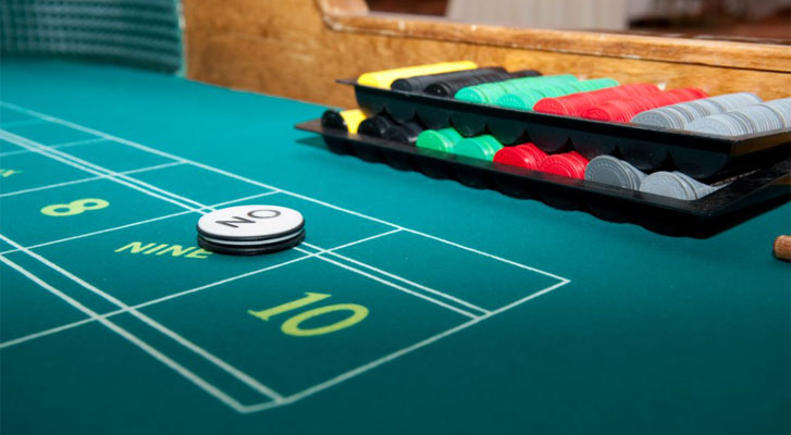 Image: Gambling table. Themed event development by Benchmarc360.