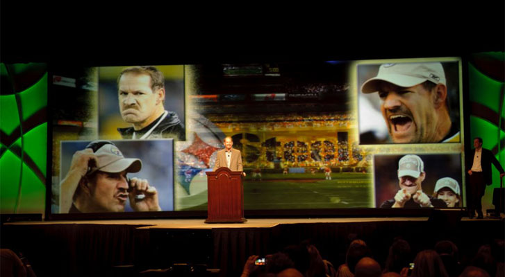 Image: Former NFL coach speaks at a corporate event. Sports event marketing, strategy and development by Benchmarc360.