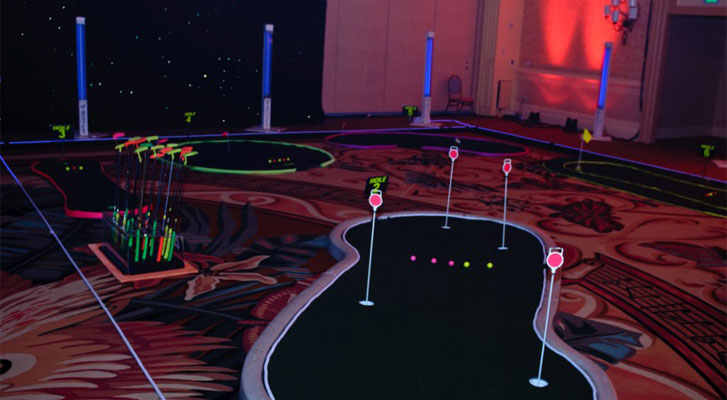 Image: Cosmic putt-putt. Recreational activity planning and corporate team builidng activiites organized by Benchmarc360.